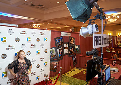 step and repeat photo station with prints